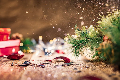 Glitter Being Scattered Over A Broken Christmas Ball Stock Photo - Download Image Now