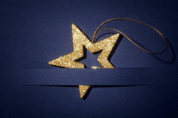 きらめく星青いクリスマスカードグリーティングスビジネス背景紙の写真 ストックフォト