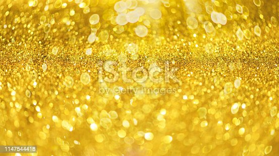 881350776 istock photo Glitter defocused abstract background with blurry lights, stars. Christmas festive texture. New year party 1147544418