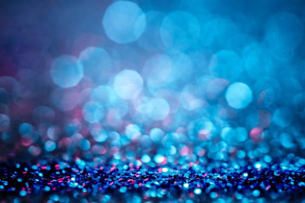 glitter intreepupil lichten blauwe achtergrond - confetti stockfoto's en -beelden