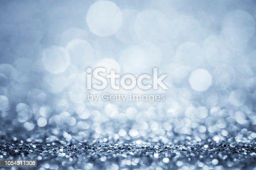 Glitter defocused lights blue - silver background