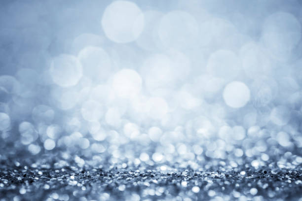 Glitter defocused lights blue - silver background stock photo