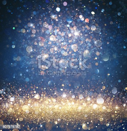 istock Glitter Gold And Blue With Sparkling Of Stars 607979782