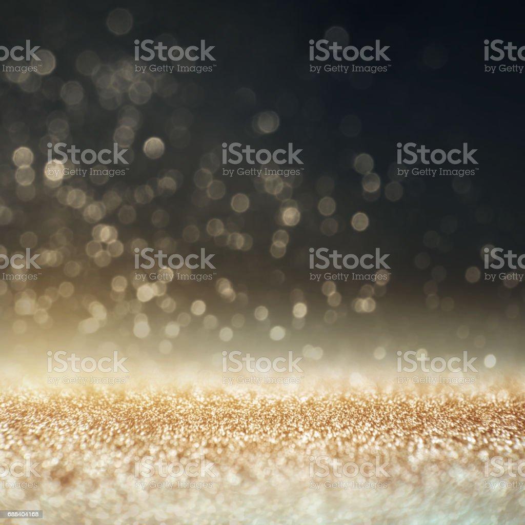 Glitter gold, silver, dark blue and black vintage lights background....