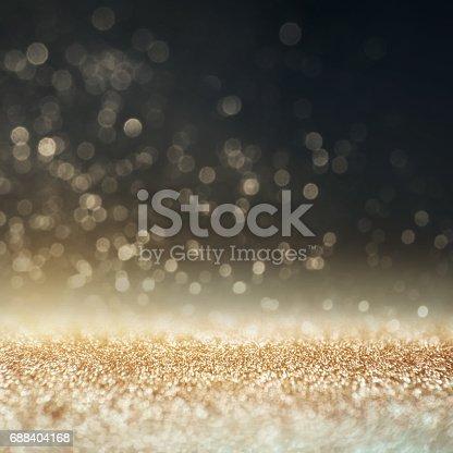 613518332 istock photo Glitter gold, silver, dark blue and black vintage lights background. 688404168
