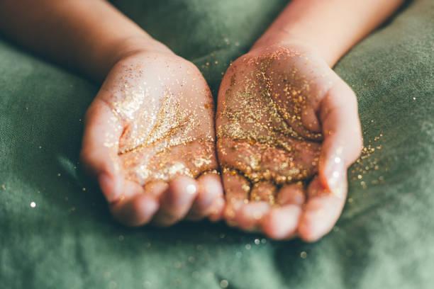 Glitter in girl hands stock photo
