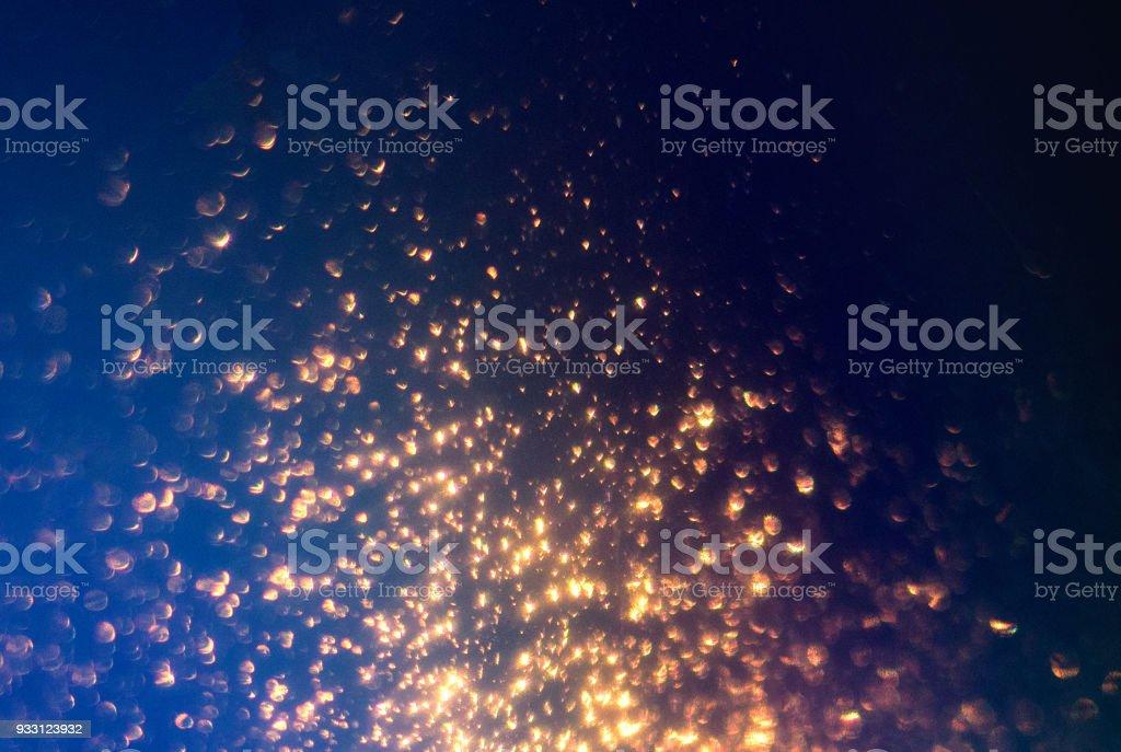 キラキラ ライトの抽象的な背景。青と黒の輝きゴールデンスターダスト デフォーカス テクスチャです。 ストックフォト