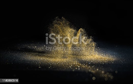 istock glitter lights grunge background, gold glitter defocused abstract Twinkly gold Lights Background. 1180892516