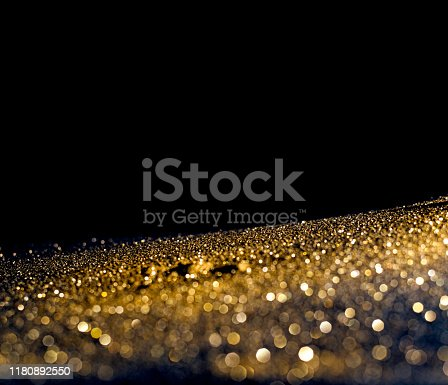 istock glitter lights grunge background, gold glitter defocused abstract Twinkly gold Lights Background. 1180892550