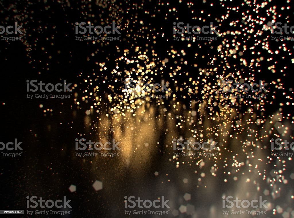 Glitter lights or sparks background. Gold and black. De-focused, bokeh stock photo