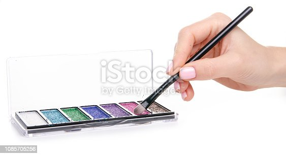 istock glitter palette sparkles with brush in hand beauty makeup 1085705256