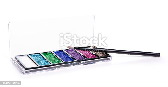 istock glitter palette sparkles with brush in hand beauty makeup 1085705260
