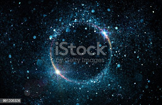 istock Glitter Particles In Circle - Abstract Black Hole 991205326