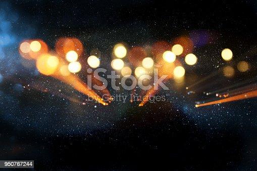 glitter vintage background. defocused. neon lights