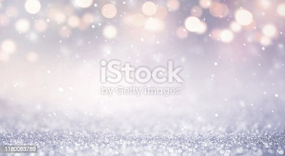 istock Glitter vintage lights abstract background new year holiday. Blue and gold, copy space. 1180053789