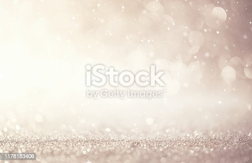 Glitter vintage lights abstract background new year holiday. Silver and white, copy space.