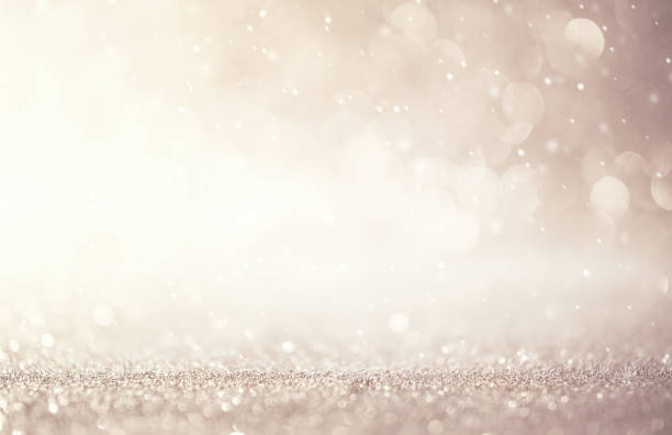 Glitter vintage lights abstract background new year holiday. Silver and white, copy space. Glitter vintage lights abstract background new year holiday. Silver and white, copy space. glitter stock pictures, royalty-free photos & images