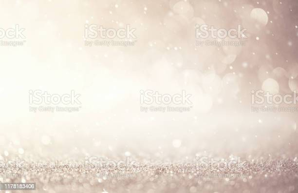 Photo of Glitter vintage lights abstract background new year holiday. Silver and white, copy space.