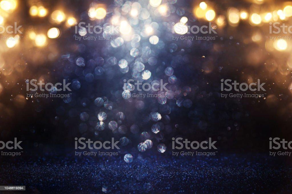 キラキラ ビンテージ ライト背景。ブラック、ゴールド、ブルー。逆に焦点を当てた。 ストックフォト
