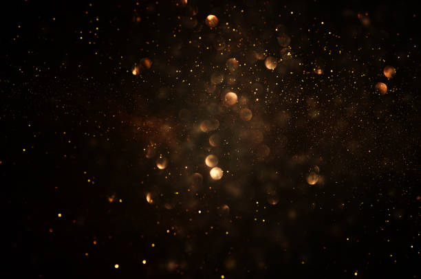 glitter vintage lights background. dark gold and black. de focused. – zdjęcie