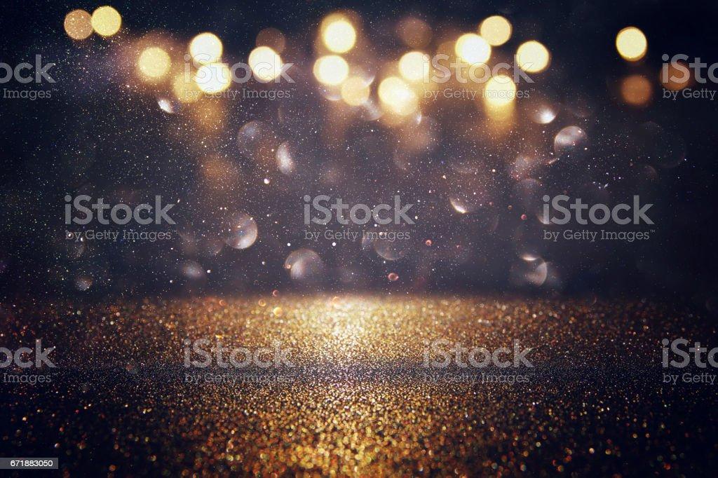キラキラ ビンテージ ライト背景。金と黒 ストックフォト