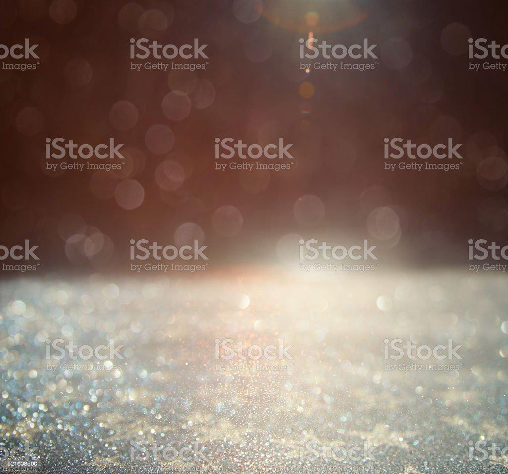glitter vintage lights background. gold, silver and black. defoc stock photo