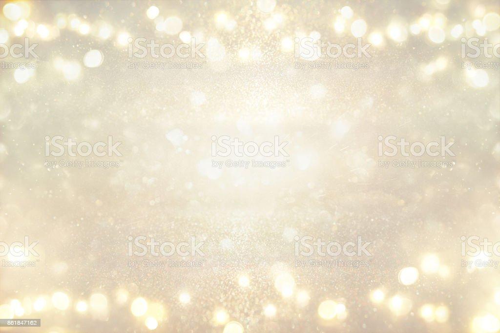 glitter vintage lights background. silver and light gold. de-focused stock photo