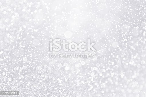 istock Glitter Winter Snow Fall White Silver Background or Shiny Bling Sparks 872285396