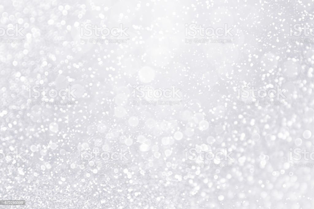 Glitter Winter Snow Fall White Silver Background or Shiny Bling Sparks stock photo
