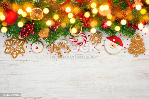 istock Glittered Christmas background, decorated holiday tree branches and copy space 1044688966
