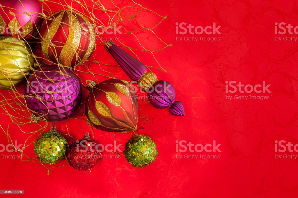 Glittered Christmas Ornaments In Jewel Colors Against Red Background ...