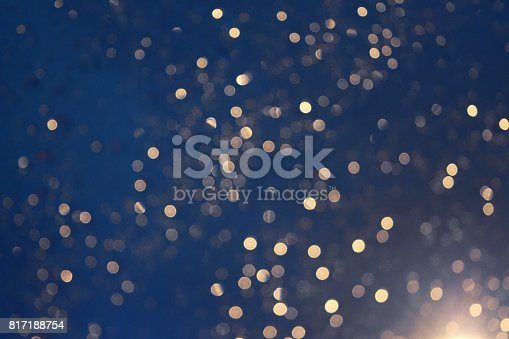 istock Glittering blur circular gold on blue background and  bright. 817188754