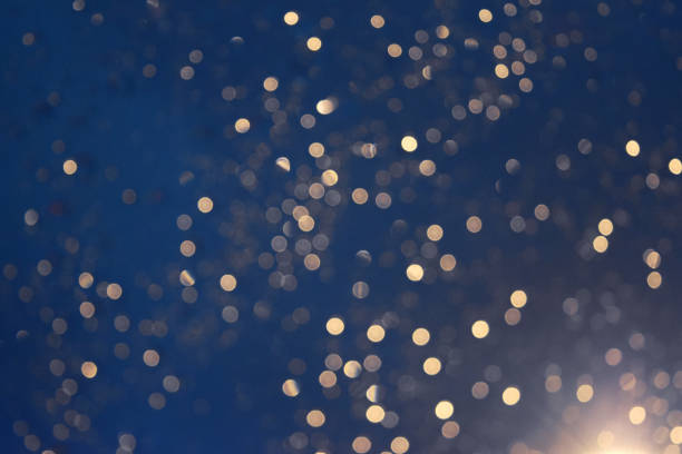 glittering blur circular gold on blue background and  bright. - focus on background stock photos and pictures