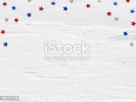 508026042 istock photo Glittering confetti stars on old grunge wooden background. 4th July, Independence day, card, invitation in usa flag colors. Top view, flat lay, empty space. 961271748