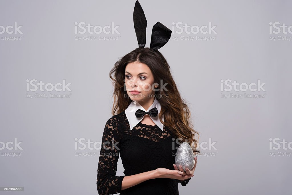 Glittering easter egg in beautiful woman's hands stock photo