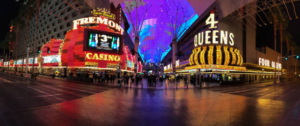 Glittering facades of Fremont and 4 Queens casinos in downtown Vegas. stock photo