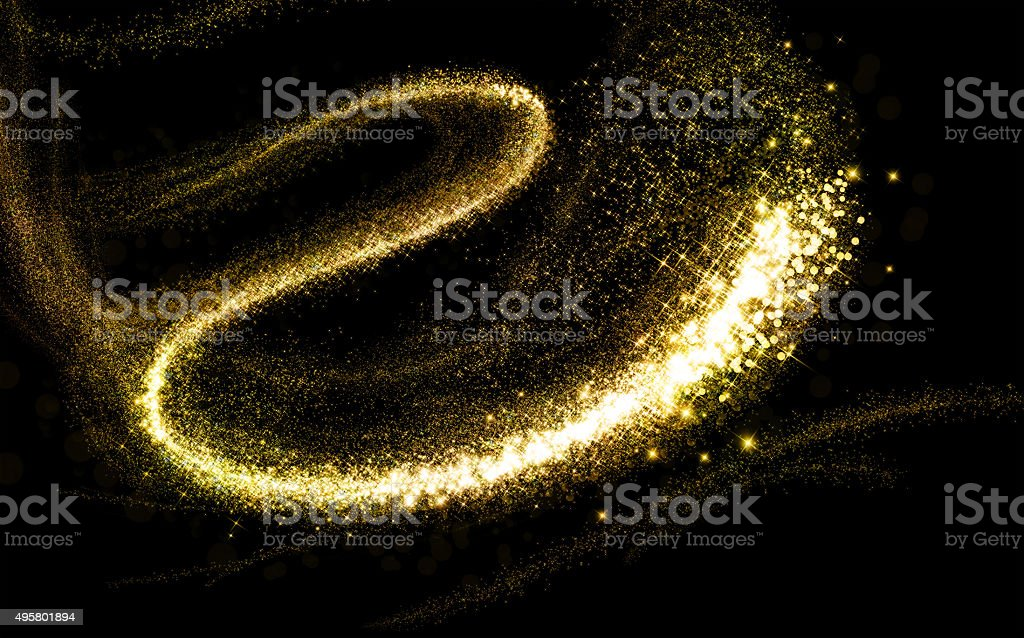 Glittering gold cosmic dust tail stock photo