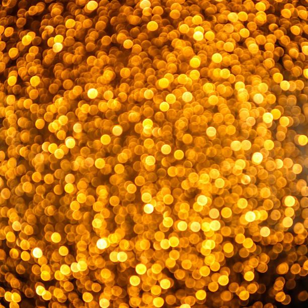 Glittering golden blurred lights
