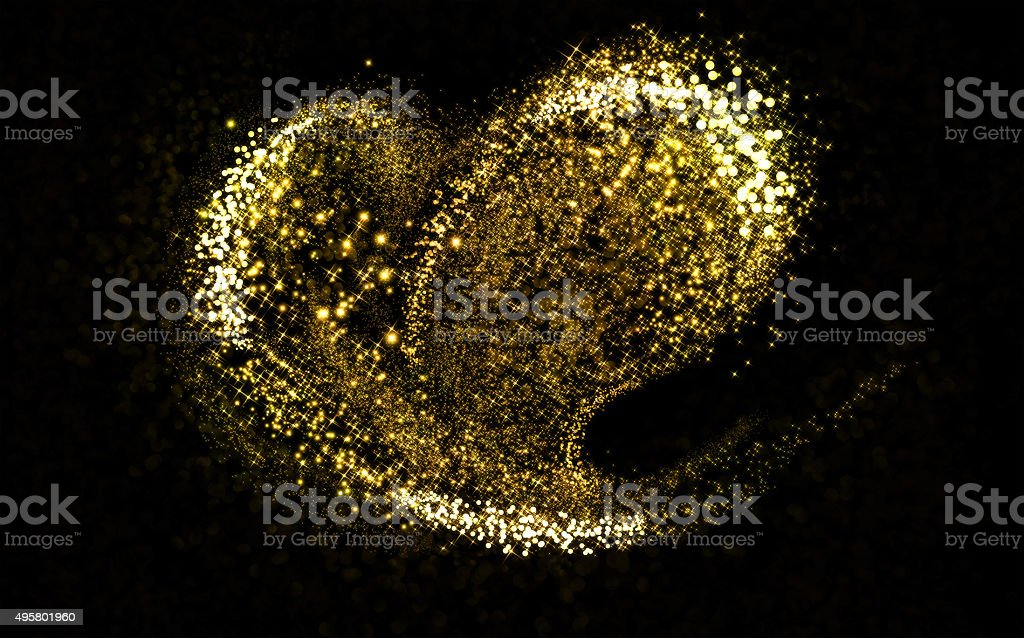 Glittering heart gold cosmic dust tail stock photo