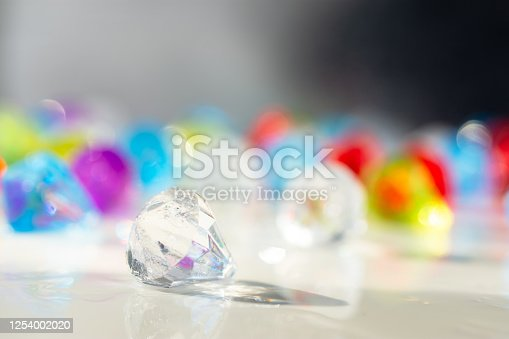 621592540 istock photo Glittering multicolored balls in unfocused form. Multi-colored blurred abstract background with bokeh. 1254002020