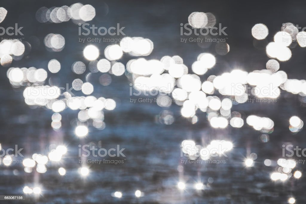Glittering sun in the surface of the ocean stock photo