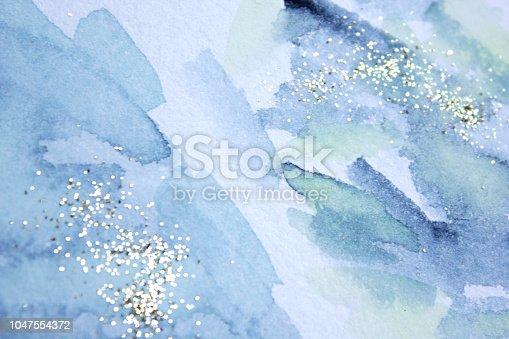 istock Glittery background. 1047554372