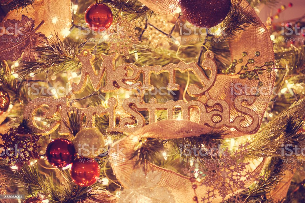Glittery Gold Merry Christmas on Christmas Tree stock photo