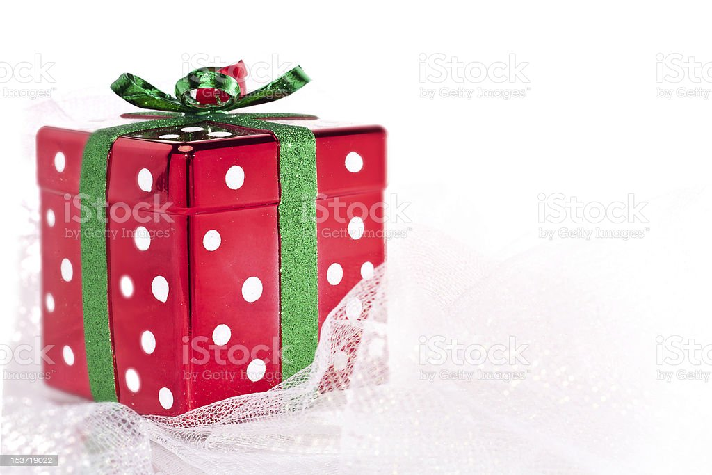 Glittery square Christmas gift box on shimmery fabric royalty-free stock photo