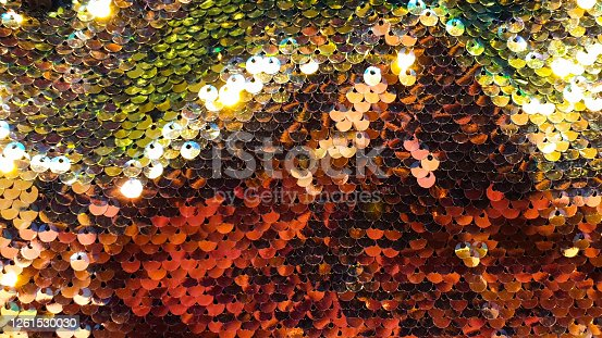 886746424 istock photo Glmour background glitter red gold and rainbow colors sequin 1261530030