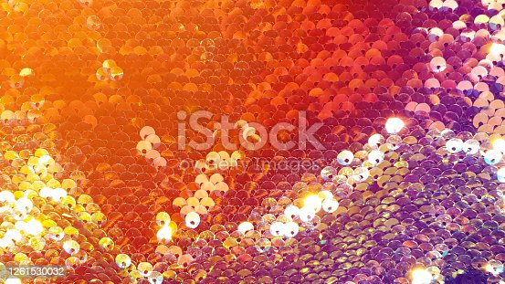 886746424 istock photo Glmour background glitter red gold and rainbow colors sequin 1261530032