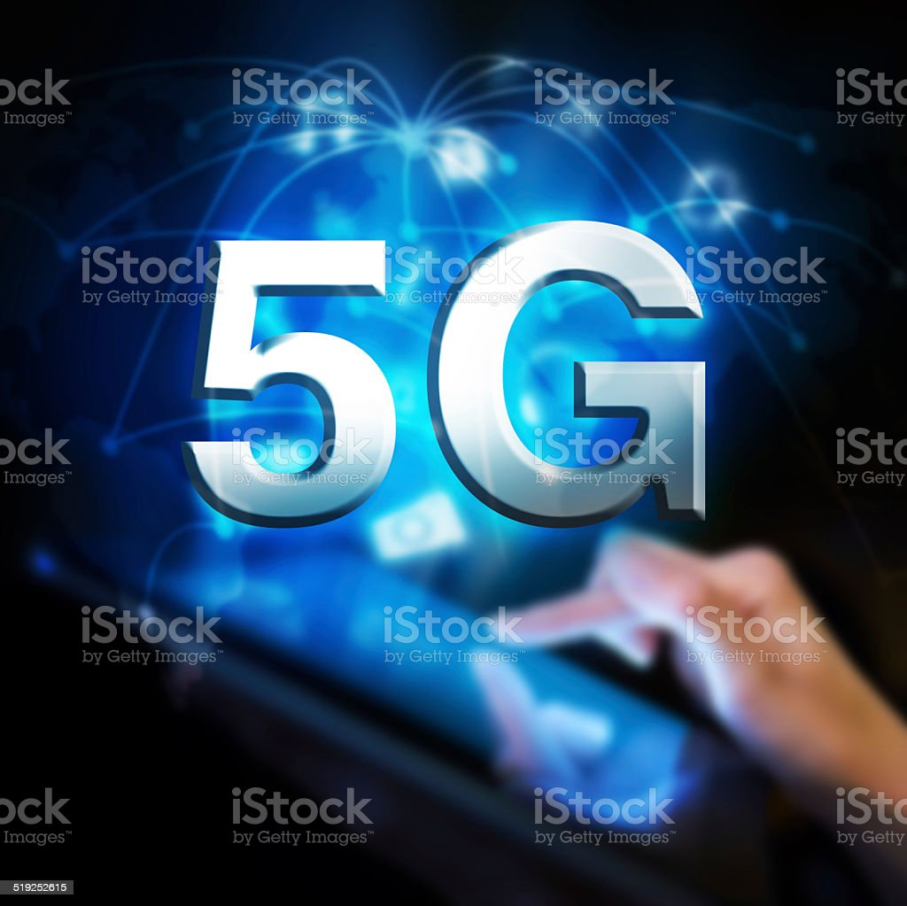 Global 5G network. Woman holding digital tablet. stock photo