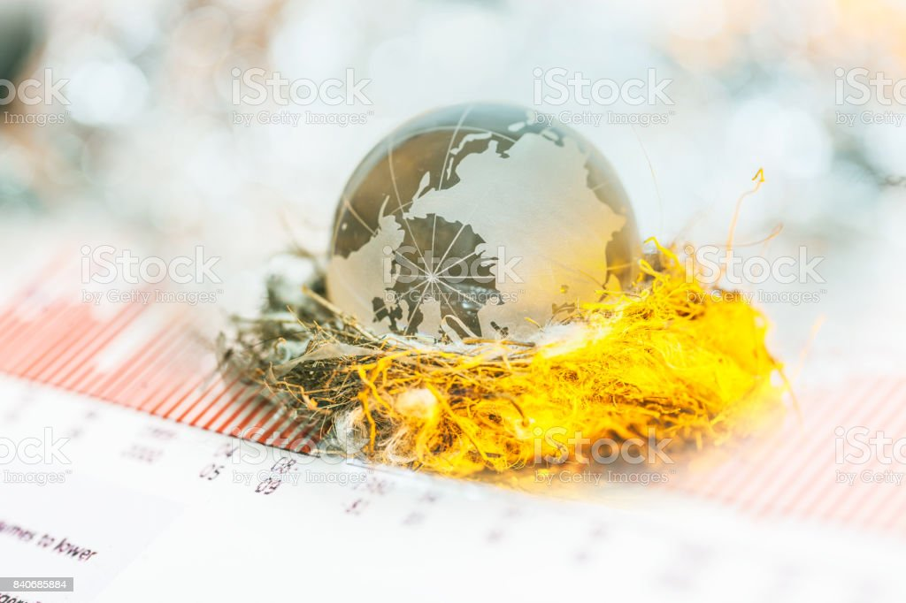 global ball on nest on financial report stock photo
