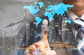 Global business concept and finance conceptual with businessman turn on power switch to connect people network communication with digital world map, money and worldwide