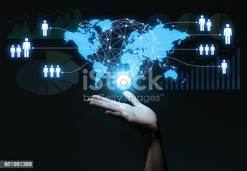 istock global business concept. human hand and world map. 851981388